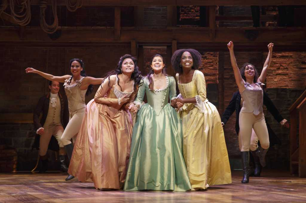 Photo courtesy Chicago Sun-Times. Karen Olivo (right), Ari Afsar (middle) and Samantha Marie Wright (left) star as the trio of sisters, Angelica, Eliza, and Peggy Schuyler, respectively.