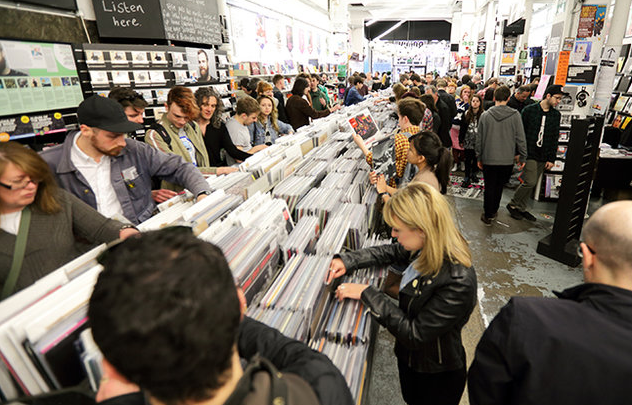 Music+fans+flip+through+vinyl+at+their+local+record+store+on+the+industry%E2%80%99s+biggest+day+of+sales.