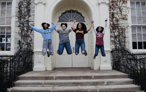 Seniors Rana Muratoglu, Nikole Tzioufas, Hope Marwede, and Maddy Javier celebrate their college decisions in front of the doors of their soon to be alma mater.