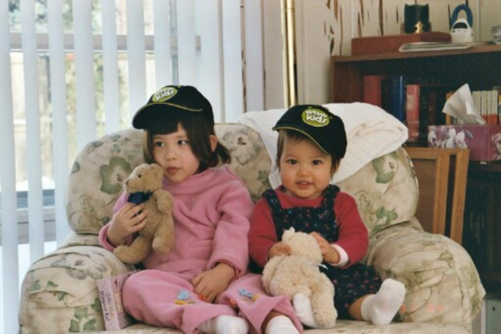 My sister Margot (right) and I with Mr. Buffles and Mr. Bear, our respective stuffed animals.