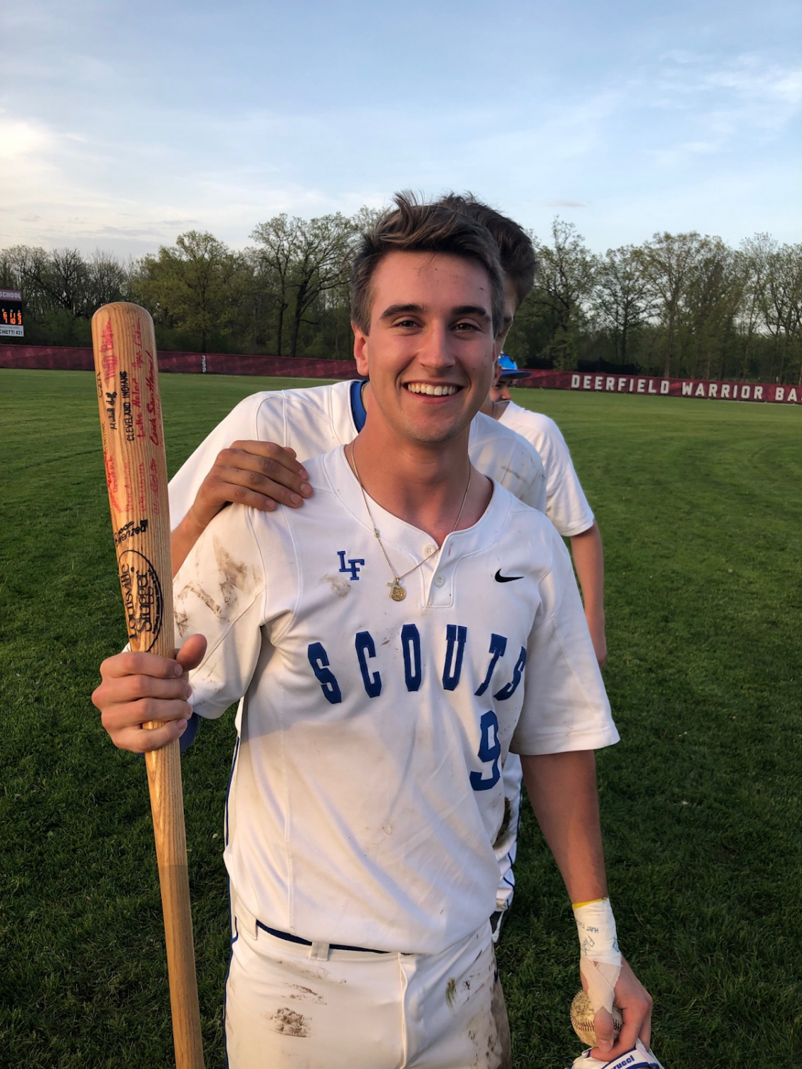 Colton Pfeifer with the Commitment Bat after the Scouts defeated Prospect, 7-6, in extra innings of Wednesday's regional semifinal game.