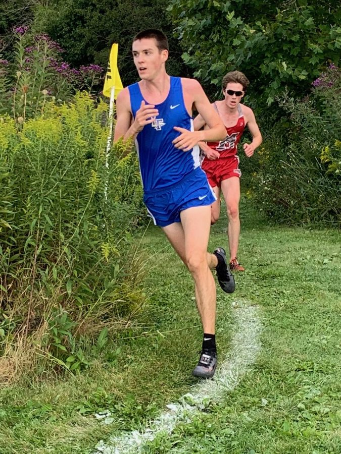 Senior Ben Rosa fends off competition at Lake County Invitational to win his first personal title for the Scouts in cross country.