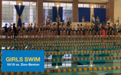 Girls Swimming lines up for the National Anthem prior to their meet against Zion-Benton on Thursday, Oct 10