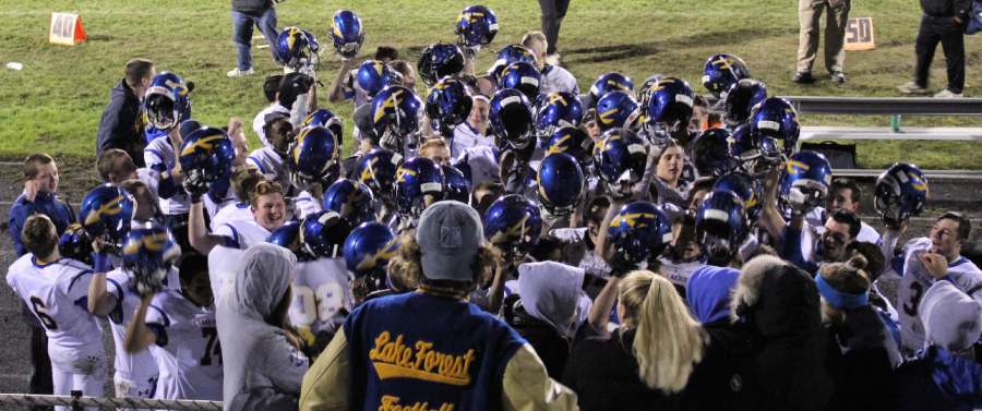 A muddy Scouts Football team sings (or hums) the LFHS fight song following a crucial road win vs. Zion-Benton, Oct 11.