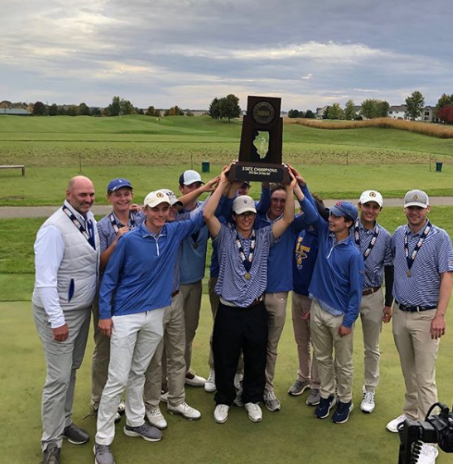 Members of the Lake Forest Golf Team hoist the State Championship Trophy at The Den at Fox Creek Golf Course, Oct 19.