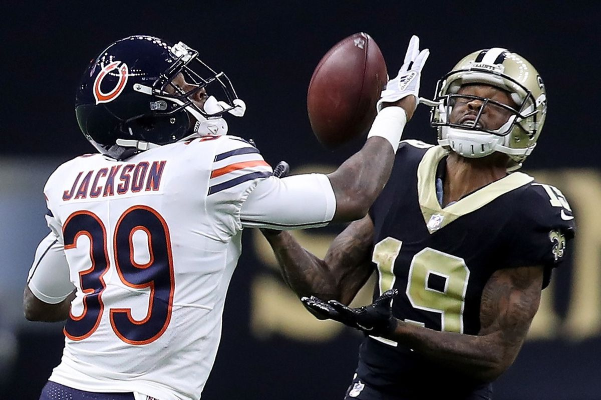 Eddie Jackson defends Ted Ginn as the Saints receiver tries to catch a pass.