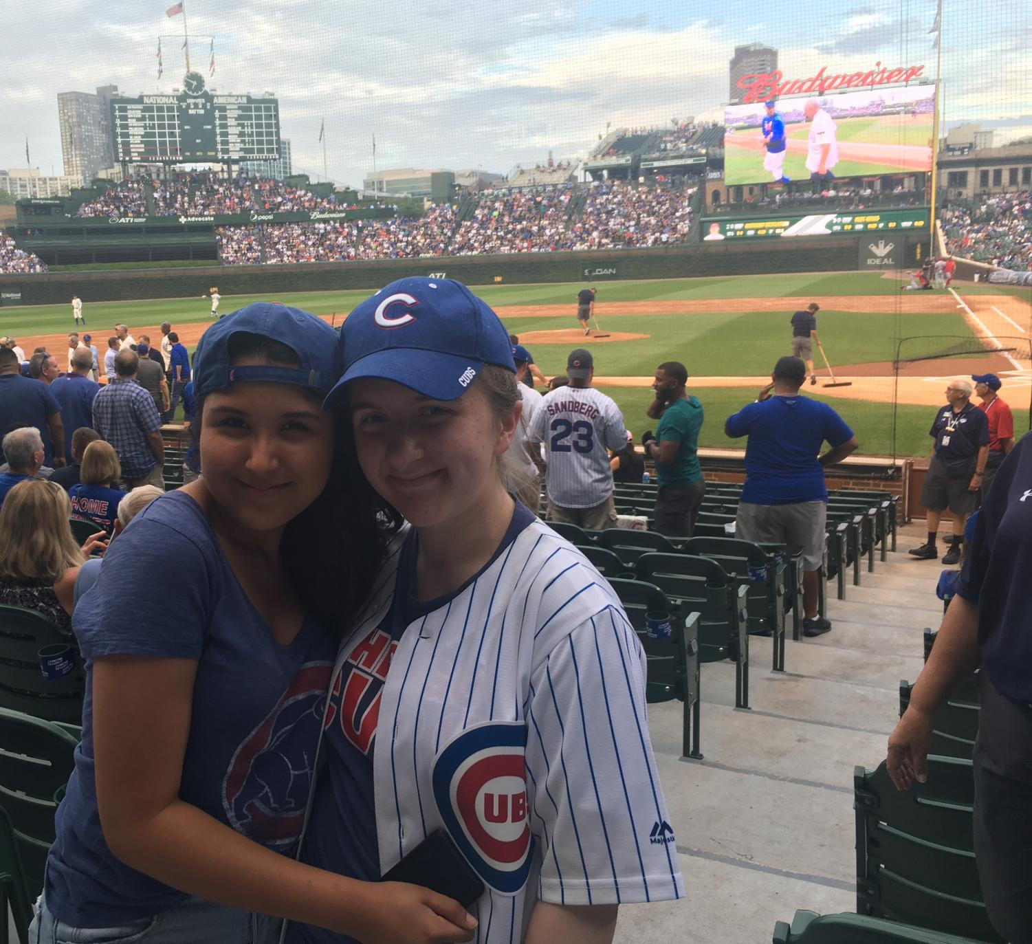 Columnist Keira Burns (right) and Isabella Ledesma at a Chicago Cubs game. Despite positive strides, female sports fans still face sexist comments and stereotypes.