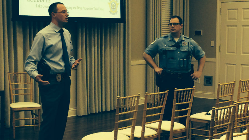 Detective Grum (left) works as the resource officer for the Lake Forest Police Department.