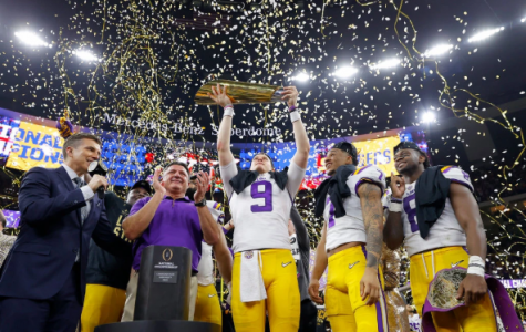 LSU Heisman phenom QB Joe Burrow raises the National Championship Trophy at the Mercedes-Benz Superdome, New Orleans.