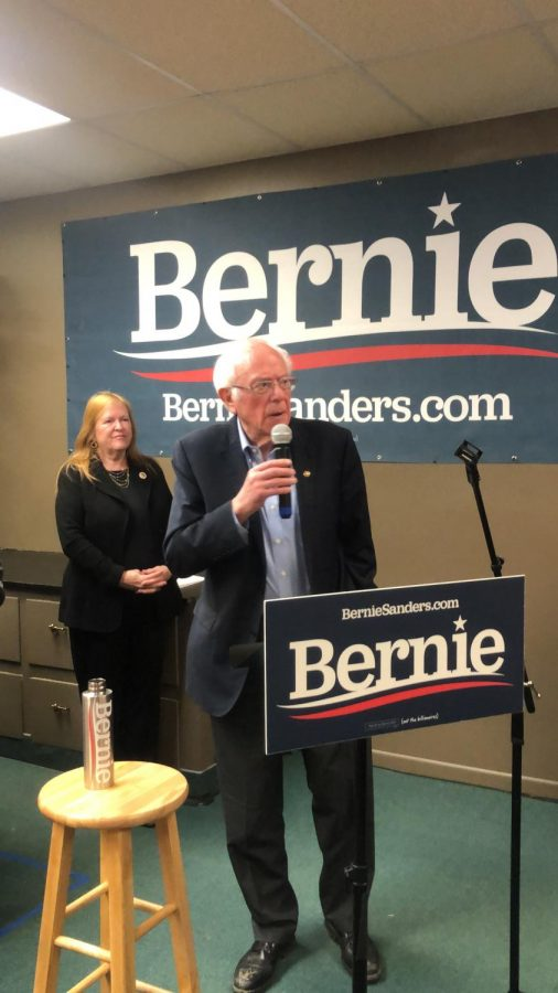 Senator Bernie Sanders (I-Vt) and his wife, Jane, address the crowd in a jam-packed office in Newton, Iowa. The rally was centered on turnout.