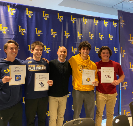 Ryan Antrim, Luke Chlystek, Michael Vallone, and Anthony Ranallo all pose with head coach Ray Del Fava following signing their NLIs on Wednesday, Feb 5.