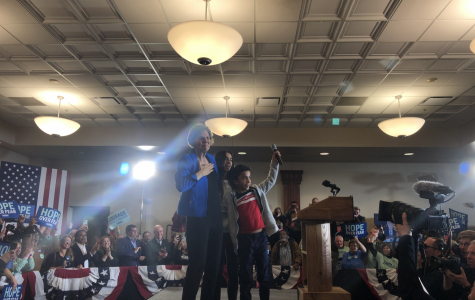 Senator Elizabeth Warren (D-Mass) and her grandchildren pose for pictures before Ms Warren's post-caucus speech. The speech ran for 15 minutes and centered on hope and keeping the campaign going.