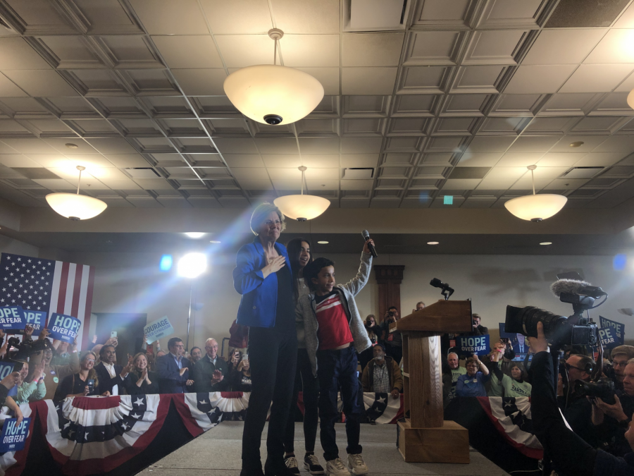 Senator Elizabeth Warren (D-Mass) and her grandchildren pose for pictures before Ms Warrens post-caucus speech. The speech ran for 15 minutes and centered on hope and keeping the campaign going.