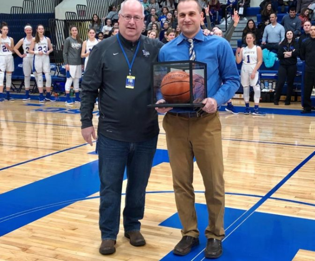 Wilhelm with head athletic director Tim Burkhalter prior to a game in 2019. He became the all-time winningest coach that season, leading the Scouts to a franchise record 27 wins.