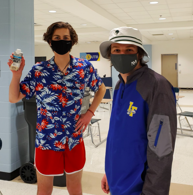 """Joseph (left) and Docherty (right) while filming a sketch for the Talent Show and staring down the """"belly of the beast"""" -- chugging a container of Non-Dairy Vanilla Muscle Milk"""