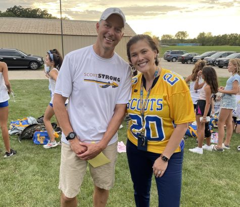 Dr. Lenart, pictured with girls cross country coach Steve Clegg, showing her support at their senior night race